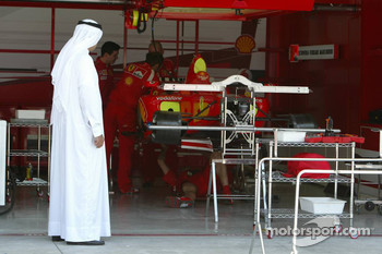 A local visitor looks into Ferrari garage area
