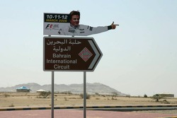 Kimi Raikkonen gives direction to Bahrain International Circuit