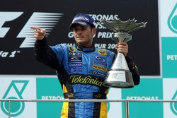 Podium: race winner Giancarlo Fisichella celebrates