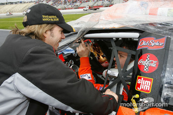 Actor David Spade speaks with Tony Stewart