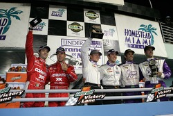 DP podium: class and overall winners Mike Rockenfeller and Patrick Long, second place Christian Fittipaldi and Lucas Luhr, third place Scott Pruett and Luis Diaz