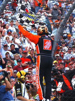 Race winner Tony Stewart celebrates