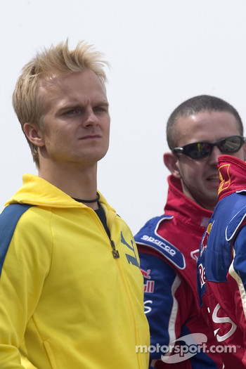 Heikki Kovalainen watches the race