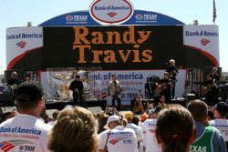 Singer Randy Travis performs during the pre race concert