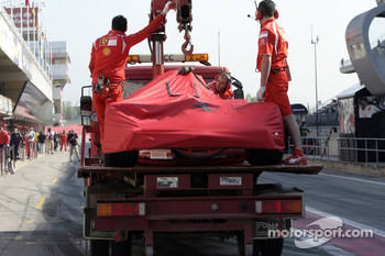 Ferrari of Michael Schumacher back to the pits
