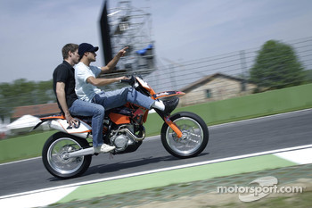 Vitantonio Liuzzi with Michael Ammermueller on his KTM