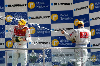 Podium: champagne for Bernd Schneider, Tom Kristensen and Mika Hakkinen