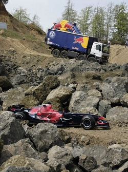 Red Bull goes off track: a Scuderia Toro Rosso racing car and a Red Bull truck