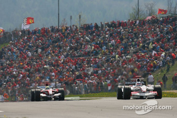 Takuma Sato in front of Ralf Schumacher