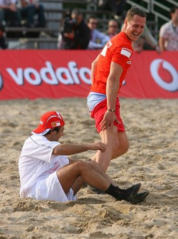 Vodafone Ferrari Beach Soccer Challenge: as Michael Schumacher stands up Felipe Massa pulls down Michael's shorts