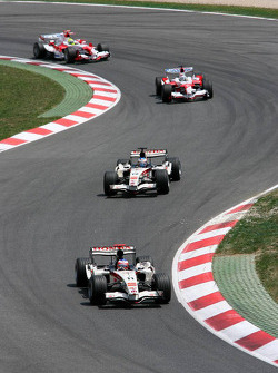 Rubens Barrichello leads Jenson Button