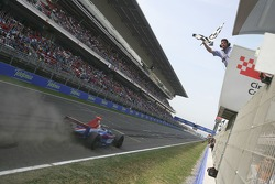 Ernesto Viso takes the checkered flag to win the race