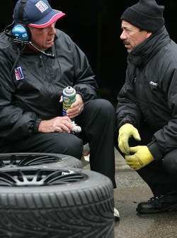 Autocon Motorsports team members prepare tires