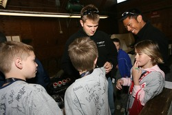 Salvation Army kids: Clint Field signs autographs
