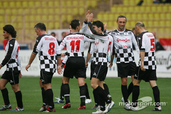 Charity football match: Giancarlo Fisichella and Michael Schumacher, celebrate scoring a goal