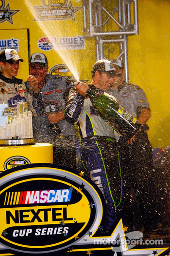Jimmie Johnson celebrates after winning the NASCAR Nextel Cup Series All-Star Challenge