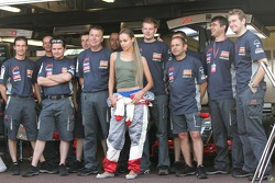 Midland F1 Team members with a model in the pitlane