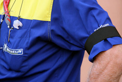 Michelin Team members wear black arm bands, in respect of Edouard Michelin, who died in a boat accident