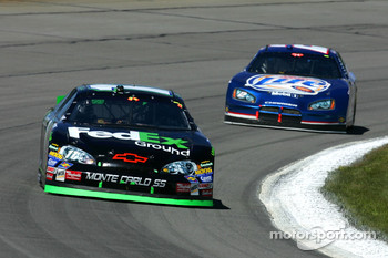 Denny Hamlin leads Kurt Busch