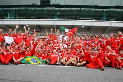 Victory celebration at Ferrari: Michael Schumacher celebrates with Felipe Massa, Jean Todt and the team