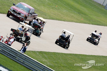 Drivers go back to the pits in golf carts