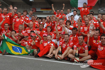 Race winner Michael Schumacher celebrates with his team