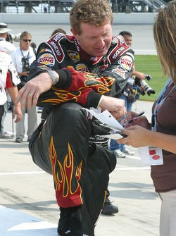 Bill Elliott checks his notes before qualifying