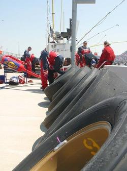 Mark Martin's crew members work on tires