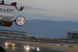 Emanuele Pirro takes the checkered flag in the Audi R10