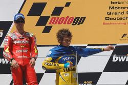Podium: race winner Valentino Rossi puts on the Team Italia shirt