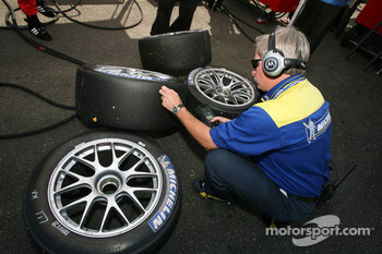Michelin technician checks tires temperature