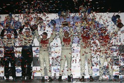 LMP1 podium: class and overall winners Rinaldo Capello and Allan McNish, with second place Frank Biela and Emanuele Pirro, and third place Chris Dyson and Guy Smith