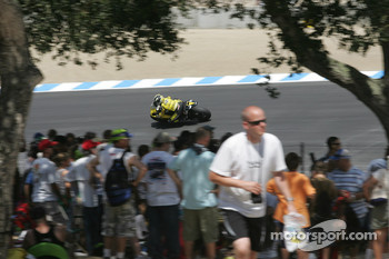 Fans watch Carlos Checa enter turn 9