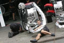 McLaren Mercedes team members prepare a fuel rig