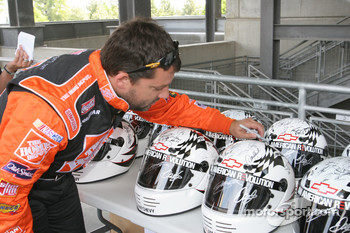 Tony Stewart signs helmets