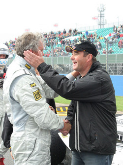 Eddie Cheever is greeted by Nigel Mansell