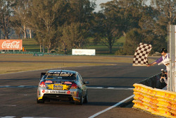 Craig Lowndes takes the chequered flag