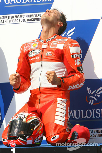 Podium: race winner Loris Capirossi celebrates