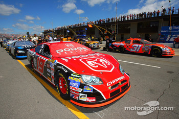 The #19 Dodge Dealers/UAW Dodge sits on pit road