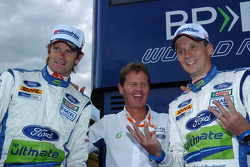 Podium: race winners Marcus Gronholm and Timo Rautiainen congratulated by Malcolm Wilson
