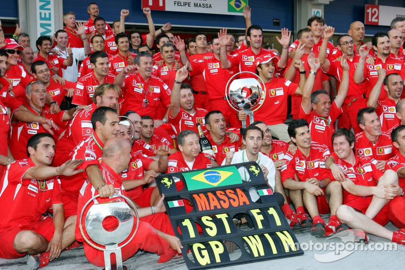 Race winner Felipe Massa celebrates with Jean Todt, Nicolas Todt, Michael Schumacher and Scuderia Ferrari team members