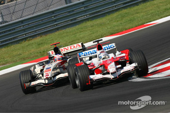 Jarno Trulli and Rubens Barrichello