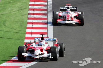 Jarno Trulli and Takuma Sato