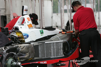 PKV Racing  crew members work on the car of Oriol Servia
