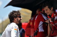 (L to R): Fernando Alonso, McLaren with Massimo Rivola, Ferrari Sporting Director