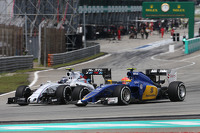 (L to R): Valtteri Bottas, Williams FW37 and Felipe Nasr, Sauber C34 battle for position