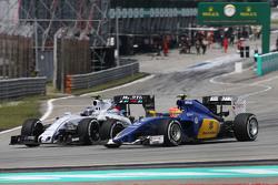 (L to R): Valtteri Bottas, Williams FW37 and Felipe Nasr, Sauber C34 battle for position