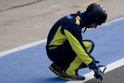 A Michelin engineer checks track temperature