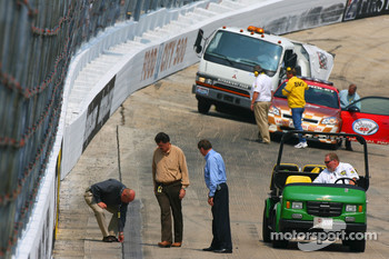John Darby NASCAR Nextel Cup Series Director, NASCAR President Mike Helton, and Robin Pemberton Vice President of Competition, inspect the track surface, prior to practice