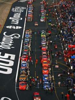 A view of the race cars lined up on pit road prior to the start